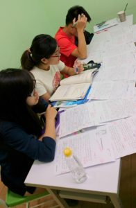 In the last Writing Task Two lesson, a student reviews her work.