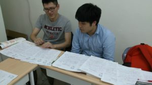 Student reviewing their four IELTS Writing Task Twos in the final Writing Task Two class.
